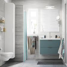 small bathroom ideas ikea a light grey small bathroom with a white high cabinet a mirror