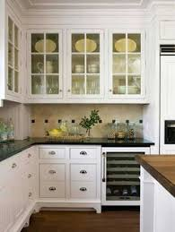 glass cupboard doors love the little pops of green in with the clean white dishes for
