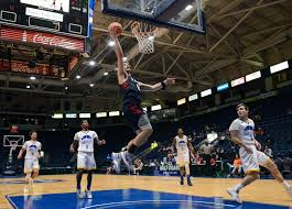 penn s basketball powers past umkc to take third place in