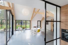 old farmhouse gets an uplifting renovation and extension farmhouse renovation by bureau fraai barn interior and glass walls