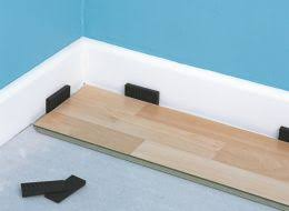 how to lay laminate and wood top layer flooring help
