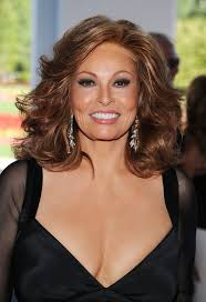 raquel welch feathered flip hairstyle with curls for older women
