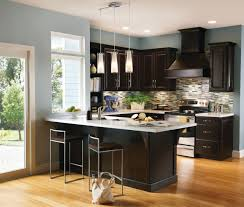wall color to go with espresso cabinets a contrasting kitchen pairs espresso cabinetry design