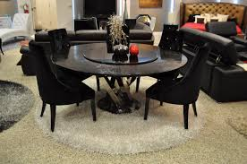 black wingback dining room chairs on round white shag rug