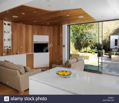 loft conversion open plan ground floor open plan living area with open patio doors stock photo royalty