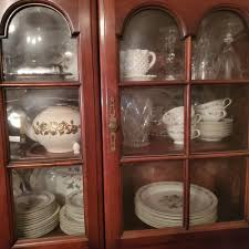 how to arrange dishes in china cabinet a china cabinet and contents plates wine glasses cups serving dishes