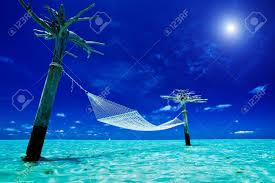 empty over water hammock in the middle of exotic tropical lagoon