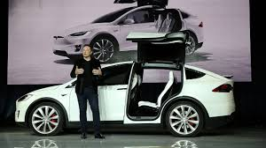 cool electric cars tesla boosts battery range elon musk promises u0027fastest car in the