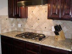Kitchen Granite And Backsplash Ideas by Light Tile Backsplash Set On An Angle To Go With The Giallo