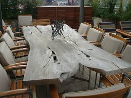 A Long Freeform Ipe Wood Slab Table And Twelve Chairs Wood Slab - Ipe outdoor furniture