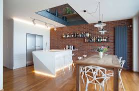 amazing apartment kitchen design with skylight and red brick stone