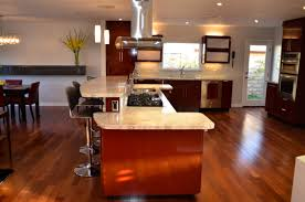 kitchen l shaped island in kitchen hard wood flooring stainless