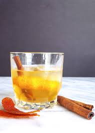 old fashioned cocktail cinnamon spiced old fashioned with muddled blood orange feast in