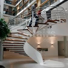 circular staircase wooden steps metal frame without risers