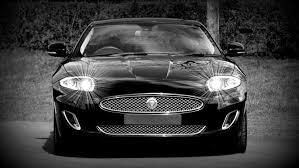 sport cars wallpaper grayscale photo of a black sports car convertible free stock photo