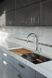 modern kitchen cabinets metal metal mesh kitchen cabinets with curved sink cutting board