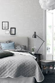 wallpapers by scandinavian designers grey headboard and picture
