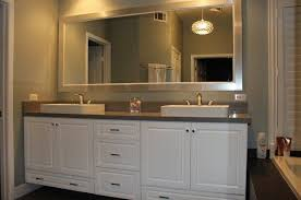 big vanity mirror with lights custom double sink vanity whits cabinets pendents lighting big