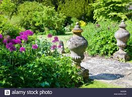 garden ornaments and purple allium or flowers