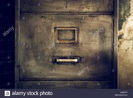 close up photo of a distressed metal filing cabinet stock photo