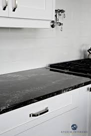 black kitchen countertops with white cabinets white kitchen cabinets 3 palettes to create a balanced and