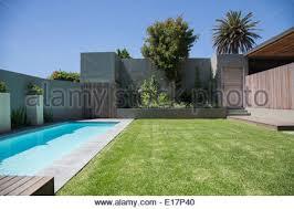 Pool In Backyard by Modern Backyard With Swimming Pool In Australian Mansion Stock