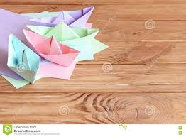 colorful ships paper folding sheets of colored paper on a wooden