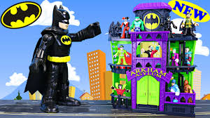 super villains attack arkham asylum prison jail superheroes