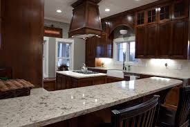 white recycled glass countertops above brown wooden kitchen island