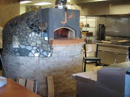an outdoor wood fired pizza oven is incredibly versatile and