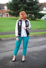 street style for over 40 how to style an embroidered bomber jacket over 40