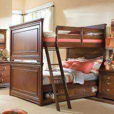 brown wooden bunk bed with ladder and double drawers on the middle