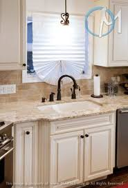 Kitchen Remodels With White Cabinets by Best Color For Granite Countertops And White Bathroom Cabinets