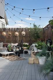 Stringing Lights In Backyard by Cute Little Outdoor Setup Sun Hats Hung On The Fence Make A
