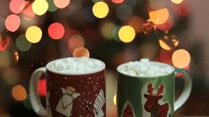 cups of cocoa with marshmallow with christmas decorations at
