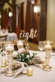 gold wedding table numbers calligraphy table numbers canmore mountain wedding at silvertip