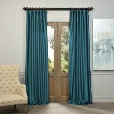 awesome blue peacock style curtain hang in decorative rod to close