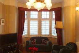 cafe style shutters in a family home in acton plantation shutters