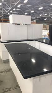 white kitchen cupboards black bench new l shape kitchen with separate island bench in high gloss