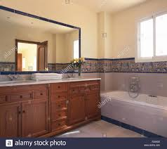 Modern Vanity Units For Bathroom by Large Mirror Above Wooden Vanity Unit In Modern Spanish Bathroom