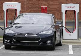 tesla adding charging stations in city centers
