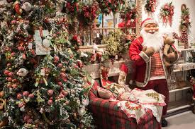santa and christmas trees on display at homi home international