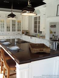 walnut kitchen island traditional white kitchen with a walnut island countertop