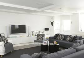 Modern Dark Gray Beige Family TV Room Design Featuring Black Wall - Modern family room furniture