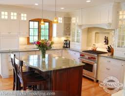 white kitchen cabinets with green countertops showpiece kitchen normandy remodeling