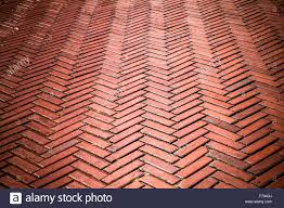 outdoor brick pavers laid in herringbone pattern stock photo
