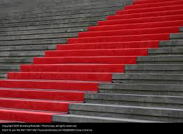 red carpet over concrete stairs low angle view a royalty free