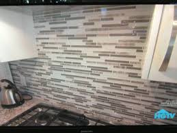 stone tile glass backsplash for a neutral gray kitchen for the