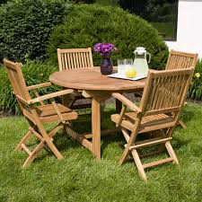 backyard outdoor dining area with expandable round oak dining