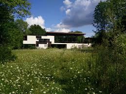 8 wood steel concrete glass home disappears landscape trendir